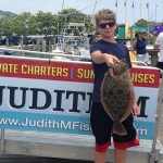 Teenage boy with a flounder on an Ocean City fishing boat dock