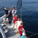 Men and young boys fishing on Ocean City charter boat