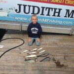 Young boy with nine fish caught on the Judith M charter boat